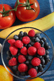 Fruits and tomato mix. Inside bowl and around Royalty Free Stock Photo