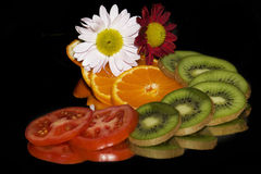 Fruits,tomtoes with the flowers Royalty Free Stock Photo