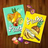 Fruits top view. Beautiful hand drawn flayers fruits on the wood Stock Images