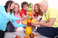 Fruits tower. Young people builing a tower Royalty Free Stock Photography