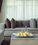 Fruits on tray with beige sofa in living room Royalty Free Stock Photography