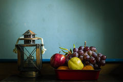 Fruits in trays and lamps on the table Royalty Free Stock Photo