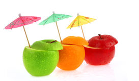 Fruits and umbrellas. Fruits and colorful umbrella on a white background Royalty Free Stock Photo