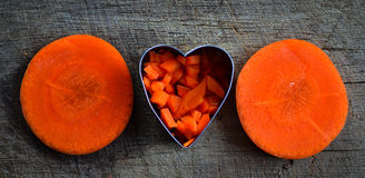 Fruits and vagatables. Heart carrot orange on wood texture Stock Image