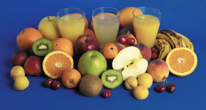 Fruits,various fruit juices with fruit next Royalty Free Stock Photos