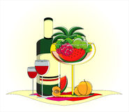 Fruits in vase with bottle of wine on served table. Fruits in vase with bottle of red wine on served table Royalty Free Stock Photos
