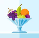 Fruits in the vase, coloured illustrations. In a blue vase fruits are grapes, pear, Apple, orange and plum. Vector illustration, color, flat Stock Images