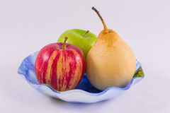 Fruits in a vase on a white background. Apples and pear fruit in a vase Royalty Free Stock Photo