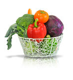 Fruits and vegetable. A wire basket full of fresh fruit and vegetables, isolated on a white background stock images