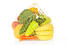 Fruits and vegetable bag over white. Royalty Free Stock Photo