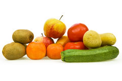 Fruits and vegetables. Assortment of fresh fruits and vegetables on white background Stock Photos