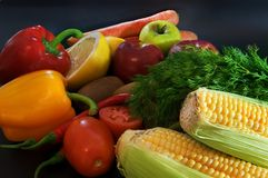 Fruits and vegetables. On black background Stock Photo