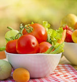 Fruits and vegetables. Fresh organic fruits and vegetables on table in bowls stock photo