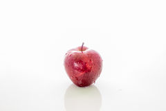 Fruits and vegetables. Apple on a white surface in a back Royalty Free Stock Photos