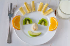 Fruits and vegetables arranged to look appealing to kids in funny face Stock Images