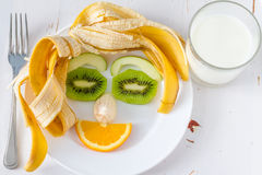 Fruits and vegetables arranged to look appealing to kids in funny face Stock Image