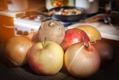 Fruits and vegetables on the background of the kitchen royalty free stock photos