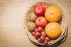 Fruits and vegetables are in the basket. Eating and traditional breakfast concept royalty free stock photo