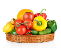 Fruits and vegetables in basket isolated on a white Royalty Free Stock Image