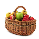 Fruits and vegetables in basket. Isolated on a white background Royalty Free Stock Photo