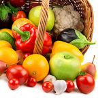 Fruits and vegetables in a basket. On white background Stock Images
