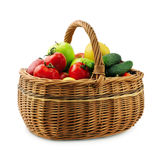 Fruits and vegetables in basket. On a white background Royalty Free Stock Images