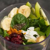 Fruits and vegetables in a blender for raw healthy smoothies. Close up royalty free stock image