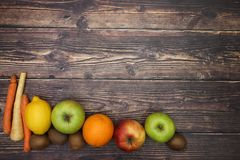 Fruits and vegetables on bottom of the table.  royalty free stock photo
