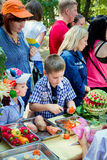 Fruits and vegetables carving workshop for children royalty free stock photography