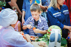 Fruits and vegetables carving workshop for children Stock Photos