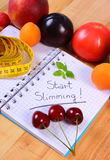 Fruits, vegetables and centimeter with notebook, slimming and healthy food Stock Photo