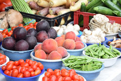 Assorted Raw Vegetables and Fruit in Bowls on Table. Cherry Tomatoes, Italian Green Beans, Zucchini, Mushrooms, Plums, Asparagus and Peaches in bowls on a Royalty Free Stock Photos