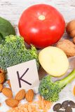 Fruits and vegetables containing vitamin K, potassium, natural minerals and dietary fiber. Fresh fruits and vegetables containing vitamin K, potassium, dietary royalty free stock images