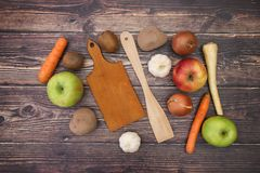 Fruits and vegetables with cutting board. Fruits and vegetables with white paper stock photography