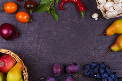 Fruits and vegetables on dark wooden background Royalty Free Stock Image