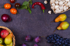 Fruits and vegetables on dark wooden background Stock Image