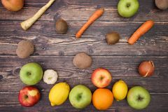 Fruits and vegetables falling. On table stock images