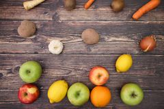 Fruits and vegetables falling on table.  royalty free stock photography