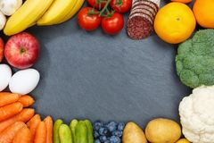Fruits and vegetables food collection frame slate copyspace from Royalty Free Stock Photos