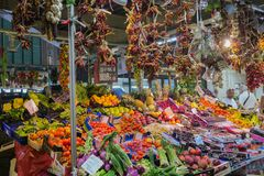 Fruits and vegetables on the food market in Firenze Florence in. Tuscany, Italy, july 7, 2018: Farmers selling healthy colorful fresh food on the famous Mercato stock photos