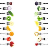 Fruits and vegetables on fork Stock Image