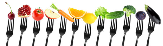 Fruits and vegetables on fork royalty free stock photos