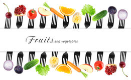 Fruits and vegetables on fork Royalty Free Stock Photo