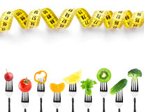 Fruits and vegetables on fork with measuring tape Stock Photos