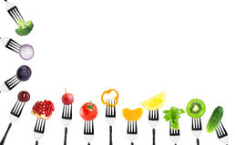 Fruits and vegetables on fork Royalty Free Stock Images
