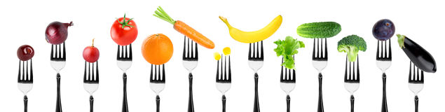 Fruits and vegetables on fork Stock Photos
