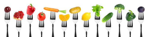 Fruits and vegetables on fork
