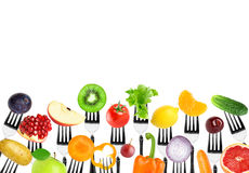 Fruits and vegetables on fork Stock Images