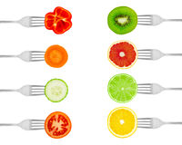 Fruits and vegetables on forks Stock Photos