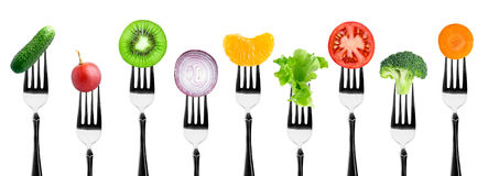 Fruits and vegetables. On the forks. Healthy food Stock Photos